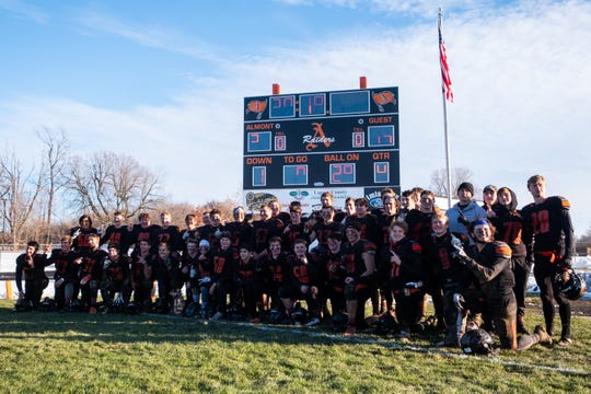 The Almont High School football team pose for a photo after defeating Saginaw Swan Valley in the MHSAA Division 5 regional finals Saturday, Nov. 16, 2019, at Almont High School.