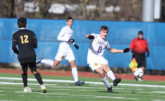 Rhinebeck's Gideon Rothchild (8) feeds a pass up field in the NYSPHSAA boys Class C soccer semi-finals against Voorheesville at Middletown High School on Saturday, November 16, 2019.