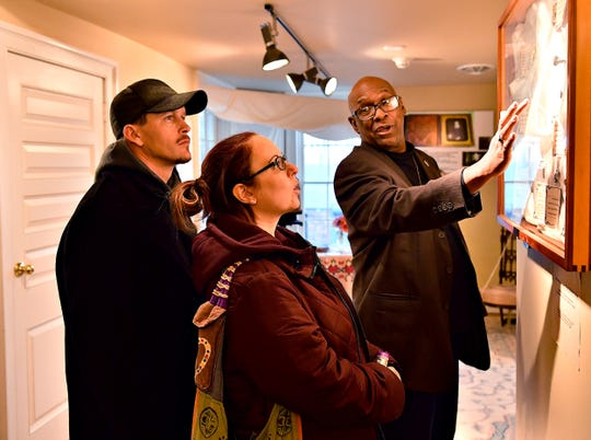Museum Manager Kelly Summerford, right, guides visitors Brett and Amy Quickle, of Evans City, Pa., on a tour of the center during the Festival of Trees at the William C. Goodridge Freedom Center & Underground Railroad Museum in York City, Saturday, Nov. 16, 2019. Dawn J. Sagert photo