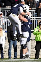 Nov 16, 2019; University Park, PA, USA; Penn State Nittany Lions quarterback Sean Clifford (14) celebrates with offensive linesman Michal Menet (62) after scoring a touchdown during the first quarter against the Indiana Hoosiers at Beaver Stadium. Mandatory Credit: Matthew O'Haren-USA TODAY Sports