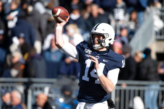Penn State quarterback Sean Clifford (14) passes in the first quarter of an NCAA college football game against Indiana in State College, Pa., on Saturday, Nov. 16, 2019. (AP Photo/Barry Reeger)