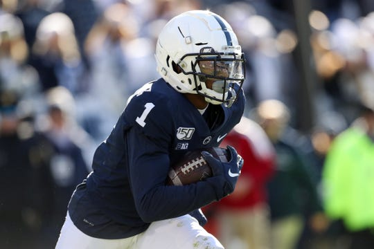 Nov 16, 2019; University Park, PA, USA; Penn State Nittany Lions wide receiver KJ Hamler (1) runs with the ball on a punt return during the first quarter against the Indiana Hoosiers at Beaver Stadium. Mandatory Credit: Matthew O'Haren-USA TODAY Sports