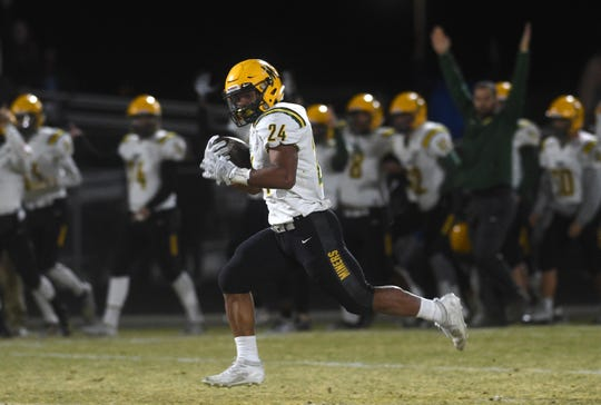 Bishop Manogue's Zeke Lee (24) runs free for a score while taking on Spanish Springs during their game on Nov. 15, 2019.