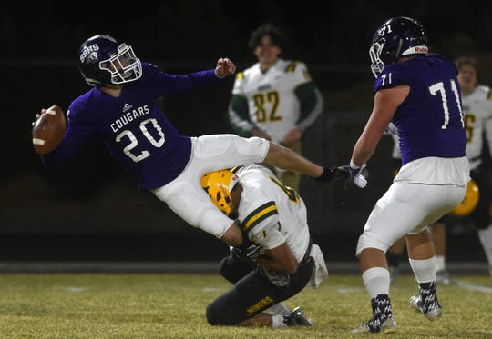 Spanish Springs' Tristan Szabo looks to pass while taking on Bishop Manogue during their game on Nov. 15, 2019.