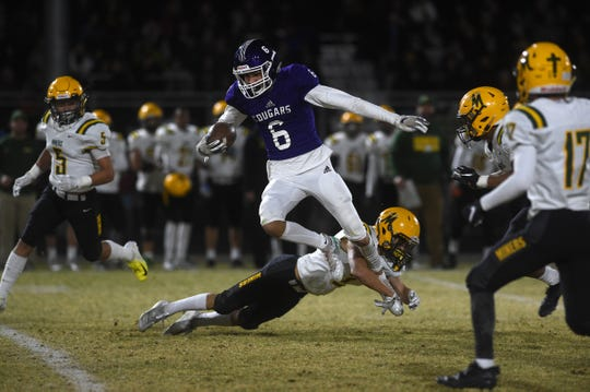 Spanish Springs' Trey Hummel runs after a catch while taking on Bishop Manogue during their game on Nov. 15, 2019.