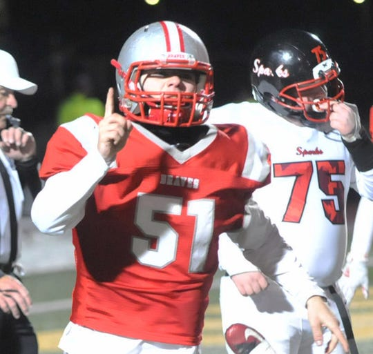 Dalton Boylan of Canandaigua celebrates his second-half quarterback sack in the Braves' 24-6 victory.