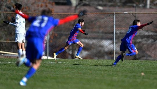 Fairport's Jude Rouhana, center, celebrates his game-winning goal against Shenendehowa during a NYSPHSAA Boys Soccer Championships Class AA semifinal in Middletown, N.Y., Saturday, Nov. 16, 2019. Fairport advanced to the Class AA final with a 1-0 win in double overtime against Shenendehowa-II.