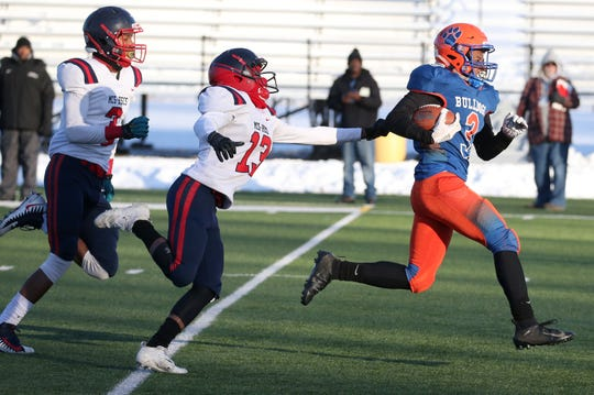 Livonia's Marcus Lewis, (3), right, breaks away from Western New York Maritime Charter defenders to score the opening touchdown of the game during the Class B Western Regional at the College at Brockport Saturday, Nov. 16, 2019.  The score put Livonia up 6-0, but they ended up losing the game 40-29.