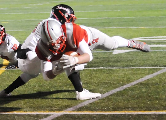 Running back Zachary Wantuck of Canandaigua dives for this second-quarter touchdown. The Braves beat undefeated Buffalo South Park 24-6.