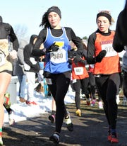 Irondequoit's Candace Tytler runs with the crowd after the start of the Class A race. She finished 22nd.