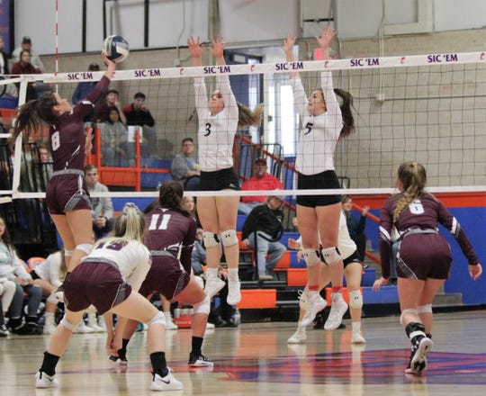 Water Valley's Kirstyn Greebon (left) and Baily Dawson go up to try to block an attack by Bronte's Karissa Cervenka on Saturday, Nov. 16, 2019, during the Region I-1A championship match at San Angelo Central's Babe Didrikson Gym.