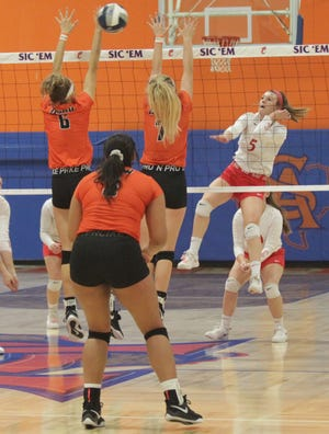 Miles High School's Tycie Lange (5) hits the ball past Wink's Dannie Akers (6) and Kyndall Garduno (7) during a Region I-2A championship volleyball match Saturday, Nov. 16, 2019, at San Angelo Central's Babe Didrikson gym.