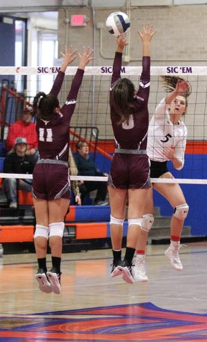 Water Valley High School's Baily Dawson (5) hits the ball against Bronte's E'lexia Davis (11) and Karissa Cervenka during the Region I-1A volleyball championship match Saturday, Nov. 16. 2019, at San Angelo Central's Babe Didrikson Gym.