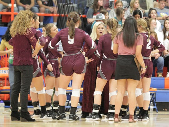 Bronte High School head volleyball coach Carol Moore discusses things with her team during the Region I-1A volleyball championship match Saturday, Nov. 16. 2019, at San Angelo Central's Babe Didrikson Gym.