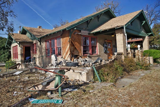 Damage to the Peasant Village Restaurant at 23 South Park St. can be seen after a single vehicle crash early Saturday, Nov. 16, 2019 left one passenger dead and the driver of the vehicle in custody.