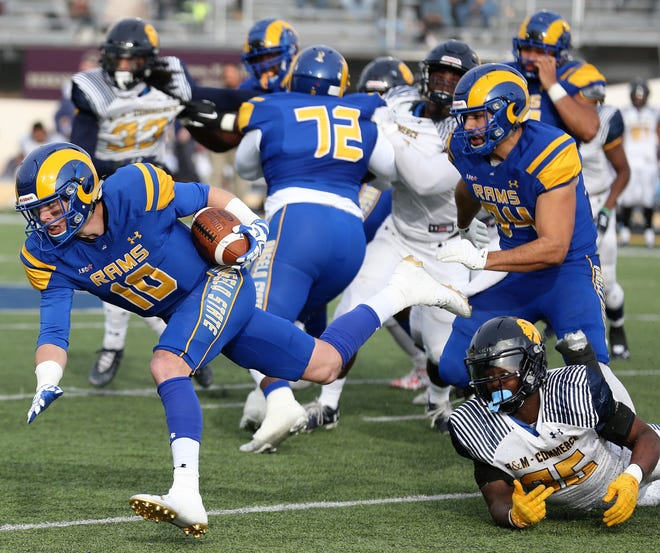 Angelo State University quarterback Payne Sullins fights for yardage against Texas A&M-Commerce during the Lone Star Conference regular-season finale at LeGrand Stadium at 1st Community Credit Union Field on Saturday, Nov. 16, 2019.