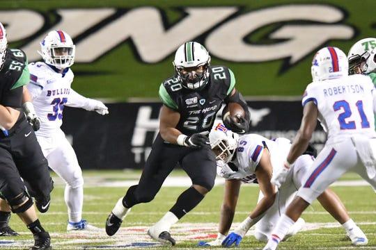 Marshall's Brenden Knox runs against the Louisiana Tech defense on Friday.