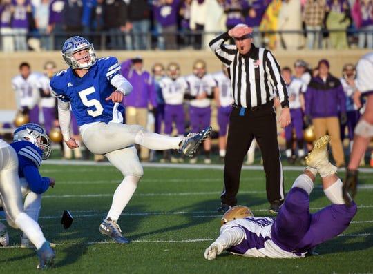 Bridgewater-Emery/Ethan quarterback Brady Hawkins kicks the ball during the Class 11B state football finals on Friday, Nov. 15, at the Dana J. Dykehouse Stadium in Brookings.