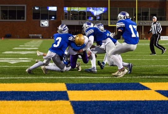 The Bridgewater-Emery/Ethan defense stops a Winner player from scoring in Winner's final drive of the Class 11B state football finals on Friday, Nov. 15, at the Dana J. Dykehouse Stadium in Brookings.