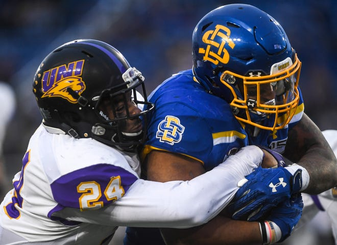 SDSU's Mikey Daniel (26) pushes past Northern Iowa's Omar Brown (24) during a Missouri Valley Football Conference game on Saturday, Nov. 16, 2019, at Dana J. Dykhouse Stadium in Brookings, S.D.