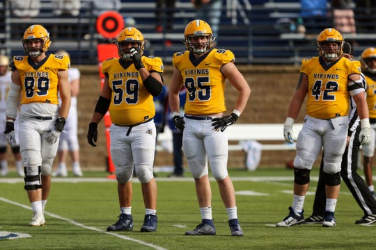 The Augustana defensive lineman look back to the sideline for the play.  They helped defeat the SMSU Mustangs 45-21 Saturday.