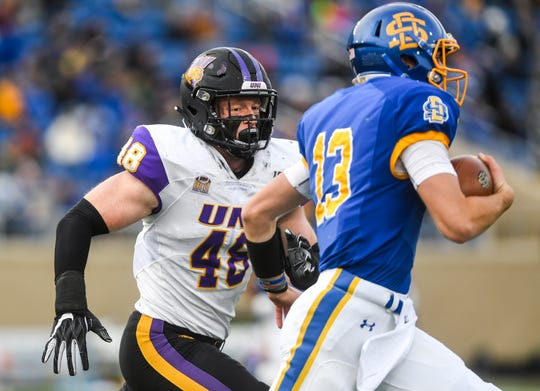 Northern Iowa's Chris Kolarevic (48) runs after SDSU's Keaton Heide (13) during a Missouri Valley Football Conference game on Saturday, Nov. 16, 2019, at Dana J. Dykhouse Stadium in Brookings, S.D.