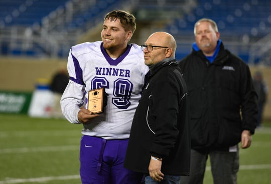 Oscar Pravecek of Winner earns the Outstanding Linesman award for the Class 11B state football finals on Friday, Nov. 15, at the Dana J. Dykehouse Stadium in Brookings.