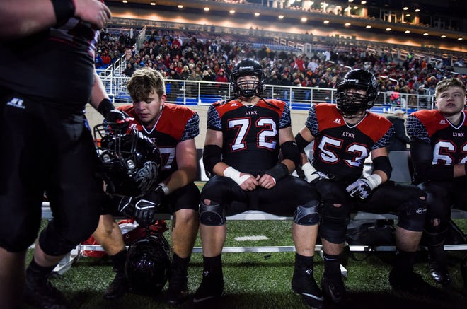 Brandon Valley players rest on the bench in the Class 11AAA state championship against O'Gorman on Friday, Nov. 15, 2019, at Dana J. Dykhouse Stadium in Brookings, S.D.