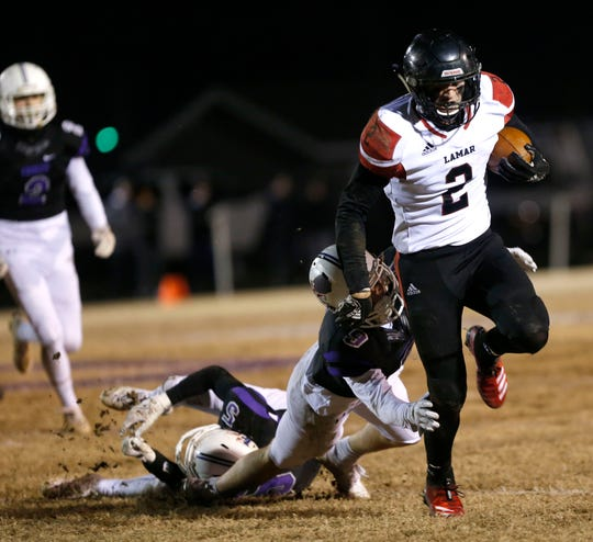 Lamar Tiger J.D. Bishop carries the ball as Fair Grove Eagle Cole Gilpin attempts to tackle him during a game at Fair Grove on Friday, Nov. 15, 2019.