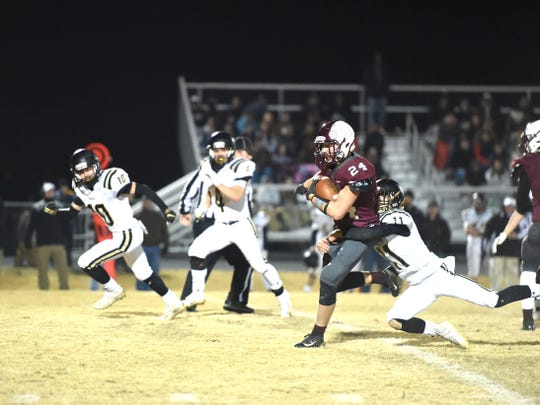 Aaron Nice tries to break free of a tackle Friday night in Stuarts Draft's win in the Region 2B playoffs.