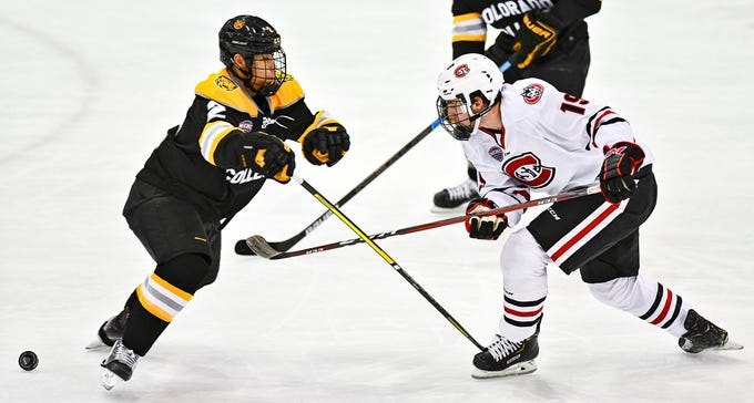 St. Cloud State's Sam Hentges skates against Chad Sasaki of Colorado College during the first period of the Friday, Nov. 15, 2019, game at the Herb Brooks National Hockey Center in St. Cloud.