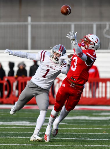 Ravi Alston of St. John's reaches to attempt to catch a pass against Rose-Hulman defender Tyce Miller during the first half of the Saturday, Nov. 16, 2019, game at Clemens Stadium in Collegeville.