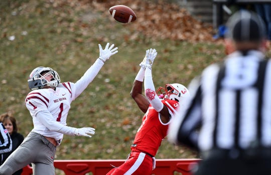 Ravi Alston of St. John's leaps to catch a pass for a touchdown during the first half of the Saturday, Nov. 16, 2019, game against Rose-Hulman  at Clemens Stadium in Collegeville.