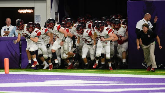 ROCORI runs onto the field before the Class 4A state semifinals against Winona Friday, Nov. 15, 2019, at U.S. Bank Stadium.