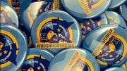"Staff for state Rep. Dan Wolgamott, D-St. Cloud, made buttons that call to ""Finish Northstar"" with a route extension to St. Cloud."