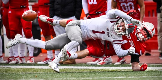 Matt Mohr of St. John's and Rose-Hulman's Tyce Miller get tangled along the sidelines as the ball bounces away during a pass play Saturday, Nov. 16, 2019, at Clemens Stadium in Collegeville.