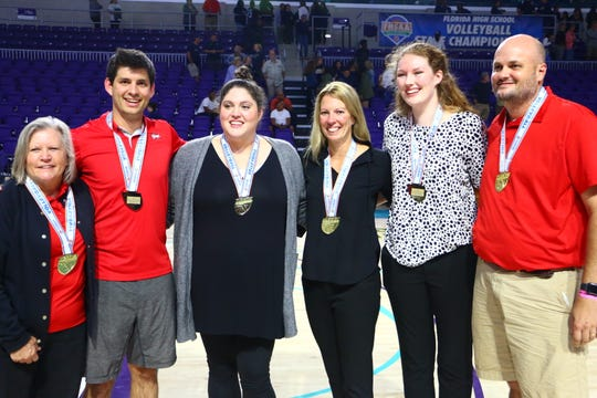 Leon's coaching staff of assistants Joy Becker, Tyler Denehan, Alison Pridgeon, head coach Angie Strickland, and assistants Erin Keller and Chris Etter after the Lions beat St. Thomas Aquinas in the Class 6A state championship game in Fort Myers.