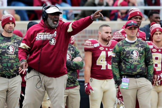 Florida State Seminoles interim head coach Odell Haggins yells at his players during a play.  The Florida State Seminoles lead the Alabama State Hornets in the first half 21-6 on Saturday, Nov. 16, 2019.