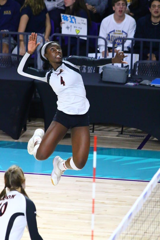 Leon's Shania Cromartie skies for a kill against St. Thomas Aquinas in the Class 6A state championship game Friday at Florida SouthWestern State College in Fort Myers.
