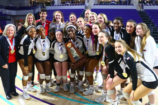 Leon poses with its Class 6A state championship trophy on Friday after beating St. Thomas Aquinas in four sets Friday at Florida SouthWestern State College.