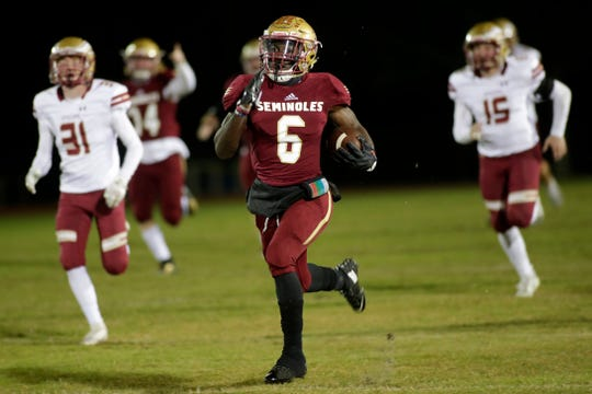 Florida High running back Alfred Menjor (6) sprints ahead of the defenders as he makes his way down the field. The Florida High Seminoles hosted the Episcopal School of Jacksonville Eagles for the Region 1-3A semifinals game on Friday, Nov. 15, 2019.