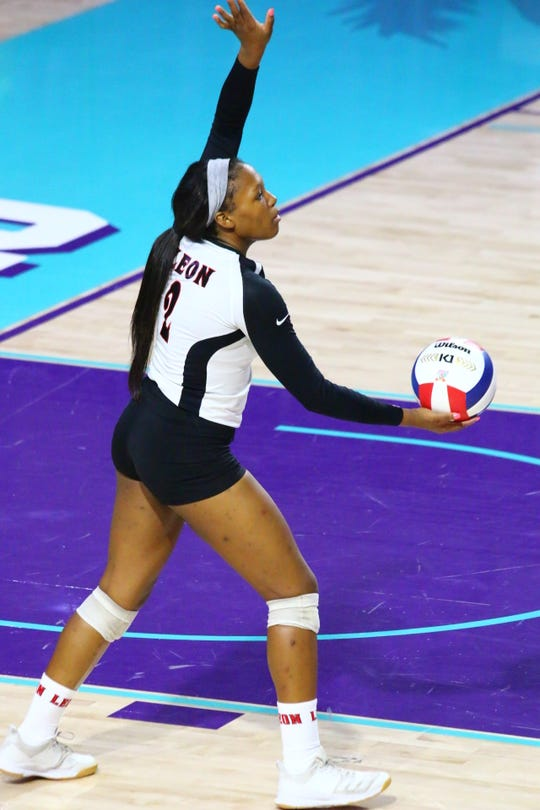 Leon sophomore Alexa Washington serves as the Lions faced St. Thomas Aquinas in the Class 6A state championship game at Florida SouthWestern State College in Fort Myers.