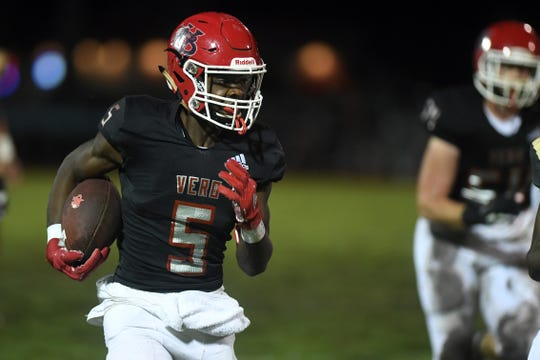 Vero Beach wide receiver Jermaine Dawson scores a touchdown on the first play of the second quarter of the Region 3-8A semifinal Friday. The Fighting Indians beat Treasure Coast 22-14.