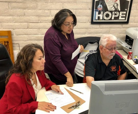 U.S. Rep. Veronica Escobar, D-El Paso, left, watches as Iliana Holguin, El Paso County Democratic Party chairwoman, and George Ybarra, the party's office manager, file documents Nov. 16, 2019, for Escobar to run in the Democratic Party primary for her congressional seat.