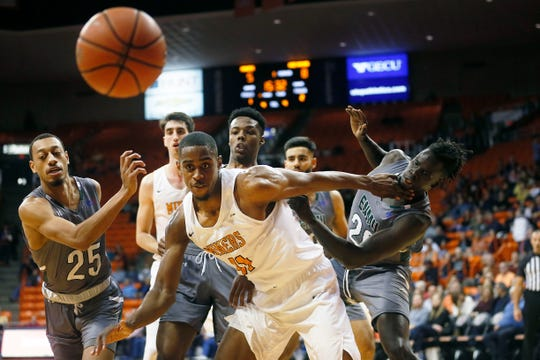 UTEP's Bryson Williams keeps an eye on the ball during the game against Eastern New Mexico Friday, Nov. 15, at the Don Haskins Center in El Paso.