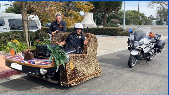 """Oxnard Officer Manny Perez made an unusual traffic stop Friday after spotting automotive personality Edd China's roadworthy couch, the """"Casual Lofa,"""" rolling through town."""