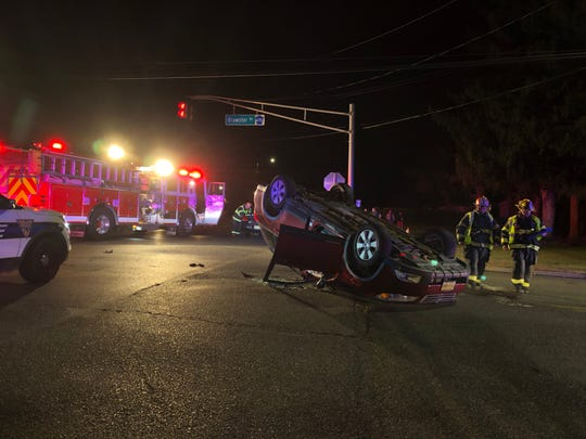 Two people were reported injured after  a vehicle rolled over during a collision at Oak and Brewster roads in Vineland. Nov. 15, 2019