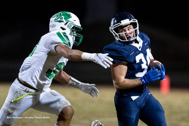 Redwood's Aram Babagian plays against St. Joseph in a Central Section Division II quarterfinal football game on Friday, November 15, 2019.
