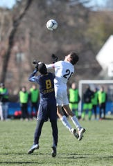 Rye's Jonathan Mehrara (20) goes up for a header in the NYSPHSAA boys Class A soccer semi-finals against Jericho at Middletown High School on Saturday, November 16, 2019.