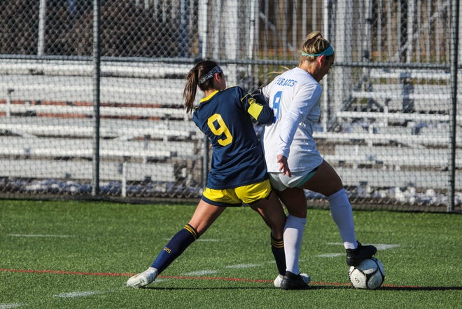 Pearl River's Kylie McNally shields the ball away from Spencerport's Julia Viavattene during the Class A state semifinal at SUNY Cortland on Saturday, Nov. 16, 2019.